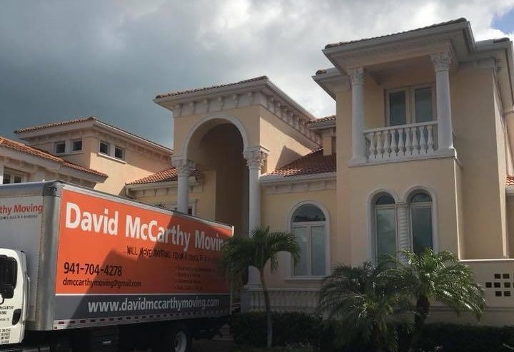 David McCarthy Moving truck parked in front of a house